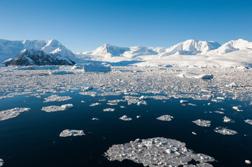 Antarctic ocean and snow mountains