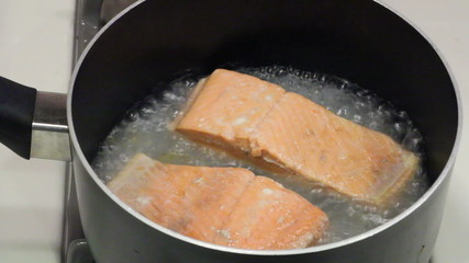 Two wild sockeye salmon fillets poaching