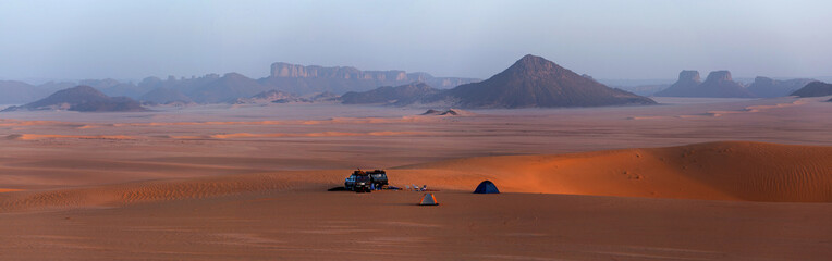 Car in the Sahara desert, panorama