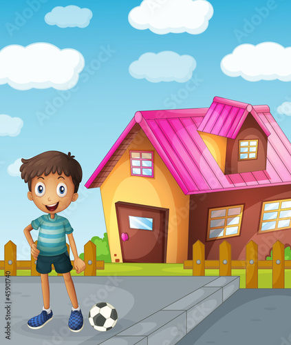 a boy, football and house