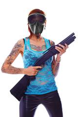 A punk girl with a shotgun