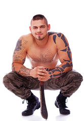 A muscular male is squatting