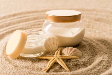 Spa body cream seashell star on sand