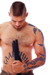 A muscular male with a gun