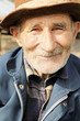 Smiling senior man in hat