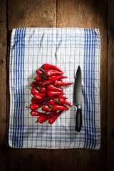 Red chili peppers with knife