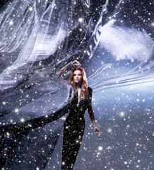 A young woman in a dark dress on a snowy silk background