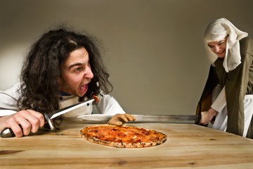 lady cutting the hand of servant who stealing the pizza