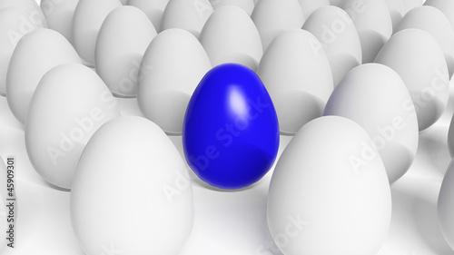 Blue Easter egg among white eggs