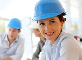 Portrait of attractive architect wearing security helmet