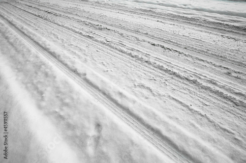 Snow on the road with track angle shot