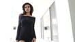 Fashion female model walking towards camera and closing door