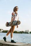 Fototapety woman with skateboard