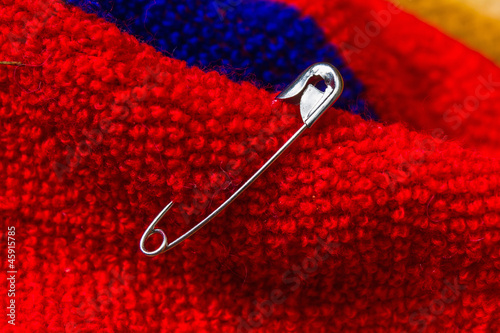 Safety pin pinned to the texture fabric