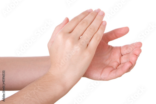 Hands applauding isolated on a white background