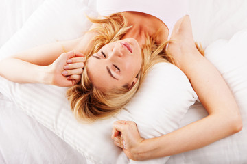 Sleepy woman stretching her arms