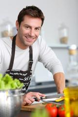 Man in kitchen preparing dinner