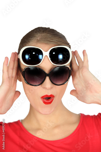Woman wearing two pairs of sunglasses
