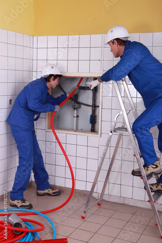 workers installing pipe