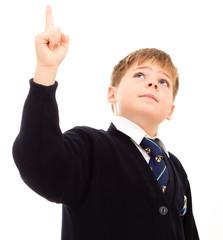 Schoolboy in hip uniform points upwards.