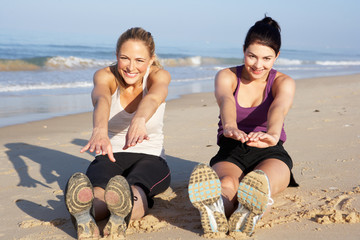 Two Women Exercising On Beach