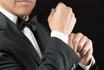 Man In Tux Fixes Cufflink