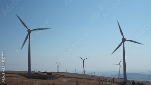 Field of wind turbines in function on a windy day