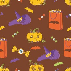 Halloween background with pumpkins, with hat, bat and candy