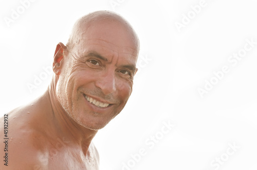 Portrait of a cheerful man on a white background