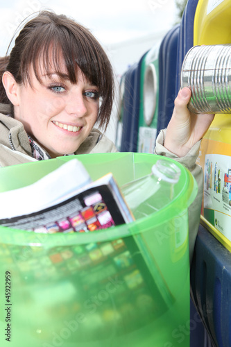 Woman placing trash in recycle bin