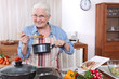 Older woman cooking a meal