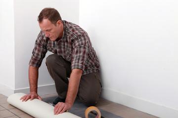 handyman laying linoleum