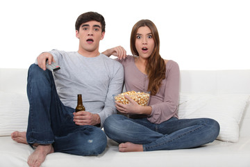 Couple watching a horror movie.