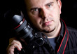 Self portrait of the photographer with DSLR camera