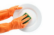Hands in rubber gloves can sponge the plate on a white backgroun