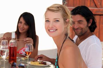 Friends eating dinner alfresco