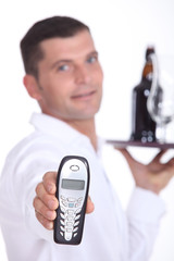 picture of waiter holding out cell phone