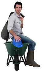 Worker with a wheelbarrow