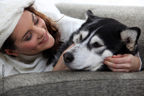 young woman cuddling her dog