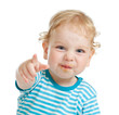 funny curly child with dirty lips pointing by finger directly to