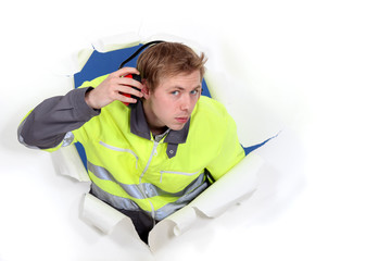 Man wearing reflective jacket and hearing protection