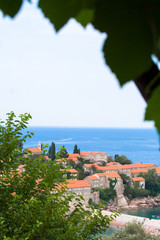 Sveti Stefan through leaves