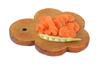 Diced carrots and haricot on cutting board