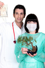 Doctor and nurse with drip and bonsai