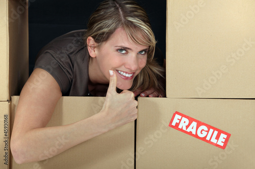 Woman stood amongst fragile boxes