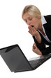 Woman yawning in front of computer