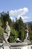 stone statues decorating peles castle gardens poster