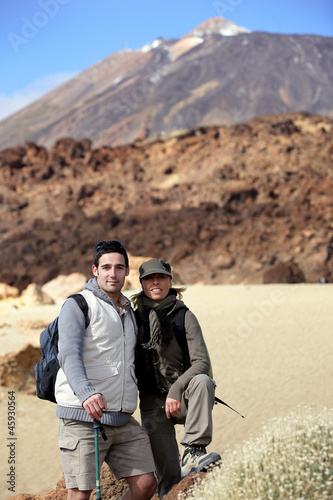 Couple of hikers in desert landscape