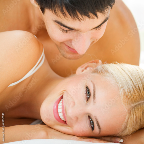 Young embracing cheerful attractive couple