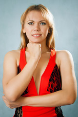 Portrait of a blond lady in red dress